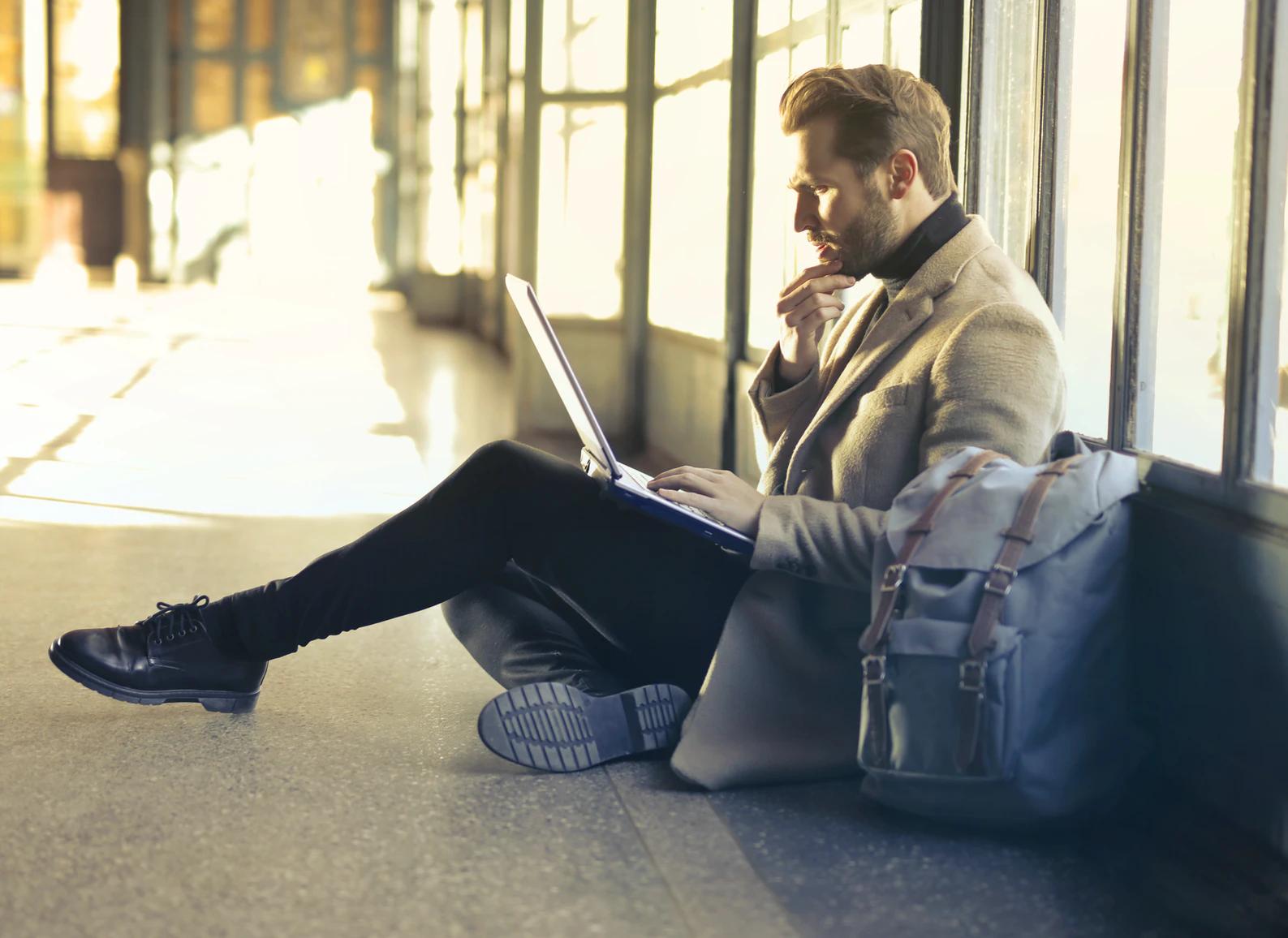 Man reading on his laptop
